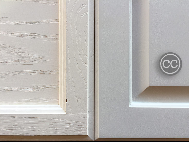 Medium oak cabinet door next to similar door with Classic Cupboards Antique White Paint